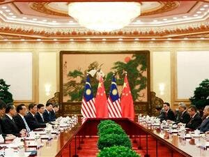 Malaysian and Chinese diplomats meet at the Great Hall of the People in Beijing on August 20, 2018. (AFP/ File)
