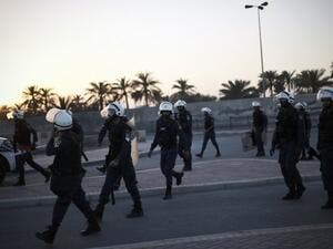 Bahraini forces raided homes in the capital Manama, arresting 10 citizens, amid ongoing protests against the government crackdown on political dissidents. (AFP/ File Photo)