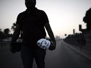 An anti-regime protester walks the streets in Bahrain. (AFP/File)