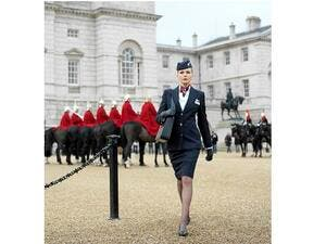 British Airways purser and The Royal Guard in London full-body.