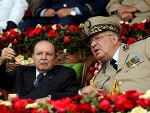 Algeria's President Abdelaziz Bouteflika gestures while talking with Army Chief of Staff General Ahmed Gaed Salah (Twitter)