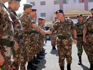 King Abdullah II shaking hands with members of the Jordanian army (AFP)