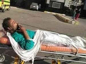widespread photos of a patient who was allowed to smoke a cigarette, while being moved in a trolley on hospital grounds in Egypt. (Twitter)