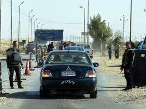 Egyptian police examine cars at a checkpoint in North Sinai. (AFP/File)