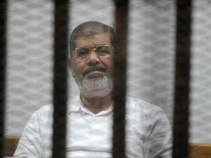 Deposed former president Mohamed Morsi in court (AFP/ File)
