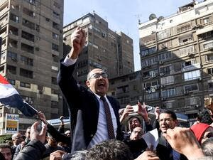 Egyptian lawyer and former presidential candidate Khaled Ali celebrates the decision amid street crowds (Mohamed El-Shahed/AFP)