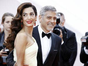 George Clooney and Amal Clooney. (Andrea Raffin / Shutterstock.com)