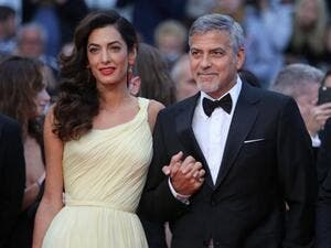 George and Amal Clooney, proud (and angry) parents. (David Silpa / UPI)