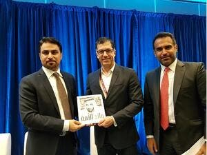 Bryan Buggey, Director, Strategic Initiatives and Sector Development, Vancouver Economic Commission, receiving a copy of the 'Father of our Nation' from Fahad Al Gergawi, CEO, Dubai FDI.