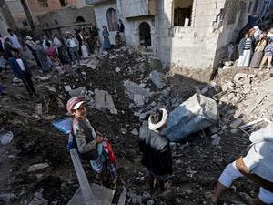 People look at the damage of an airstrike in Yemen (AFP/File Photo)