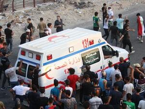 An Iraqi ambulance leaves during a protest against the government and the lack of basic services outside the regional government headquarters in the southern city of Basra on September 5, 2018. (Haidar MOHAMMED ALI / AFP)