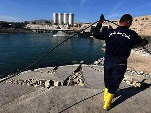 An employee works on Mosul dam. (AFP/ File)