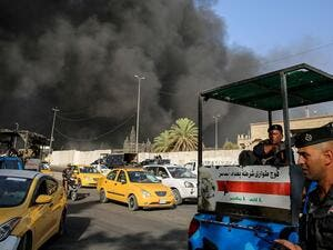 Members of the Iraqi federal police outside a ballot warehouse in Baghdad caught on fire. (AFP/ File)