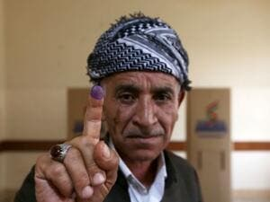 An Iraqi Kurdish man shows his ink-stained finger after voting in the Kurdish independence referendum in Arbil. (AFP/ File Photo)