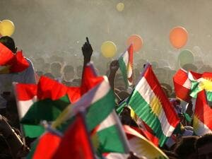 Iraqi Kurds fly Kurdish flags during an event to urge people to vote in the upcoming independence referendum in Irbil. (Safin Hamed/AFP)
