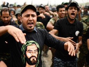 Some leading figures - such as Prime Minister Haider al-Abadi and powerful Shia cleric Muqtada al-Sadr - oppose the participation of Hashd in the elections. (AFP)
