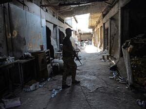 A member of Iraq's elite Counter-Terrorism Service patrols an alley during the advance towards the Old City of Mosul on June 19, 2017 as the ongoing offensive continues to retake the last district still held by Daesh fighters. (Mohamed El-Shahed/AFP)