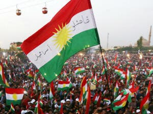 Iraqi Kurds fly Kurdish flags during an event to urge people to vote in the upcoming independence referendum. (AFP/ File)
