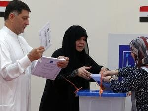 Iraqi nationals residing in the UAE cast their ballots for Iraq's parliamentary elections at a polling station in Dubai.(Karim Sahib / AFP File Photo)