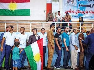 People queue to cast their votes on the Kurdish independence referendum at a stadium in Arbil yesterday. (AFP Photo)