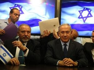 Israeli Prime Minister Benjamin Netanyahu and Avigdor Lieberman, the head of hardline nationalist party Israel Beiteinu, are seen during a ceremony signing a coalition agreement on May 25, 2016 at the Knesset. (AFP/Menahem Kahana)