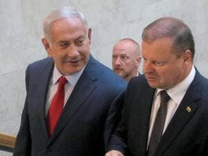 Netanyahu arrives in Lithuania with Lithuanian counterpart Sallius Skvernielis to attend the summit. (AFP/ File)