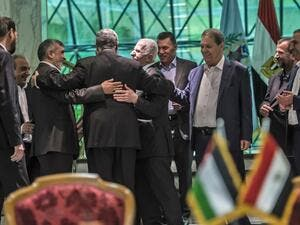 Khaled Fawzi (3rd-L) head of the Egyptian Intelligence services, shares a laugh with Hamas leader Izzat al-Rishq (2nd-L) and Fatah's Azzam al-Ahmad (C) following the signing of a reconciliation deal in Cairo on October 12, 2017 (Khaled Desouki/AFP)