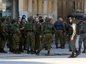 Israeli occupation army forces have detained more than 12 Palestinians including two sisters across the  West Bank. (AFP/ File)