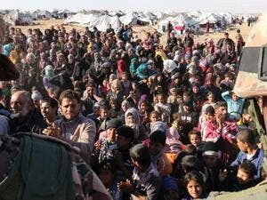 Syrian refugees are seen stranded at the Jordanian border. (AFP/Khalil Mazraawi)