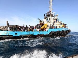 African migrants are rescued by a boat off the coat of Libya after attempting to cross the Mediterranean to Italy. (AFP/File)