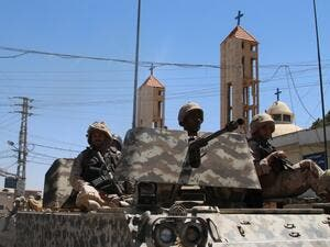 Lebanese soldiers on patrol in al-Qaa, after a series of deadly suicide bombings in the Christian town. (AFP/Stringer)