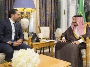 King Salman bin Abdulaziz al-Saud (R) meeting with Lebanese caretaker prime minister Saad Hariri in Riyadh. (AFP/ File Photo)