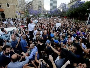 Independent parliamentary candidate Joumana Haddad speaks to members of a civil society movement rallying in front of the Ministry of Interior in Beirut contesting the unofficial results/ AFP