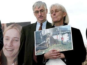 Craig and Cynthia Corrie speak about their daughter Rachel, shown on a poster, at a press conference on Capitol Hill/ AFP