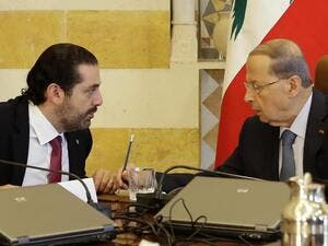 Lebanese President Michel Aoun, right, and Prime Minister-designate Saad Hariri at the presidential palace. (AFP)