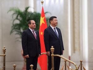 China's President Xi Jinping (R) and his Egyptian counterpart Abdel Fattah al-Sisi listen to anthems during a welcome ceremony at the Great Hall of the People on September 1, 2018. 