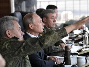 Russia's President Vladimir Putin (C), Defence Minister Sergei Shoigu (L) and Chief of the General Staff of the Russian Armed Forces Valery Gerasimov watch the Vostok-2018 (East-2018) military drills at Tsugol training ground not far from the Chinese and Mongolian border in Siberia, on September 13, 2018. 
