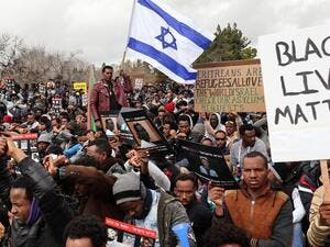 Hundreds of African migrants taking part in a protest in Jerusalem against deporting African asylum seekers last year. (AFP/File Photo)