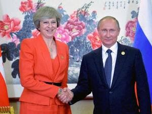 Russian President Vladimir Putin (R) meets with Britain's Prime Minister Theresa May. (AFP)