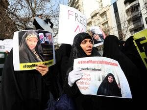 Iranians hold banners bearing messages that call for the release of US-born journalist Marzieh Hashemi, in front of the Swiss embassy in the capital Tehran on January 20, 2019. (AFP/ File)