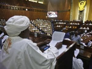 Sudanese parliament members are seated in the main chamber of the National Assembly during an emergency session discussing a state of emergency declared by the president following anti-government protests, on March 11, 2019. (AFP/ File Photo)