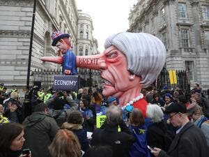 A puppet head of Britain's Prime Minister Theresa May spearing a representation of the British Economy is positioned on Whitehall outside Downing Street. (AFP/ File)