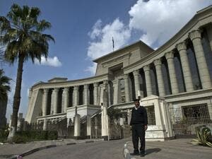 An Egyptian policeman stands guard outside the Supreme Constitutional Court in Cairo. (AFP/File)