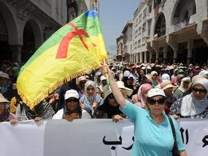 A Moroccan protester waves a flag of the Amazigh, Morocco's Berber community, during a demonstration in downtown Rabat on June 11, 2017, demanding that authorities release the leaders of a protest movement that has rocked the neglected northern Rif region for months. (Stringer/AFP)