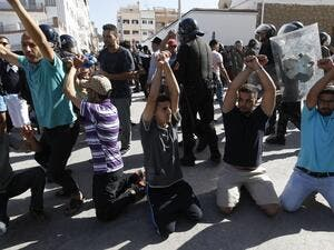 Moroccans demand the release of detained demonstrators during a banned protest in al-Hoceima, July 20 2017, during which journalist Hamid al-Mahdawoui was arrested. (AFP)