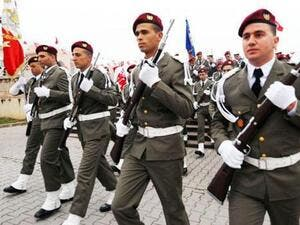 Tunisian troops takes part in an official ceremony marking the third anniversary of the uprising that ousted long-time dictator Zine El Abidine Ben Ali on Tuesday in Tunis. [AFP]