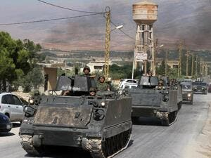 Lebanese army soldiers drive armoured personnel carriers in the northern Lebanese town of Arsal on the border with Syria on August 6, 2014. (AFP/File)