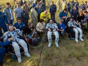 "Mission control Houston called it a ""bull's-eye landing,"" despite the capsule coming in on its side instead of an upright position. (AFP/File)"