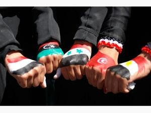 Yemeni women show their hands painted with flags of Arab nations. (AFP/File)
