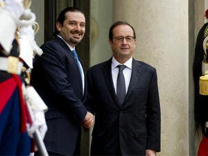 French President Francois Hollande, right, with former Lebanese prime minister Saad Hariri upon his arrival for a meeting at the Elysee Palace. (AFP/File)